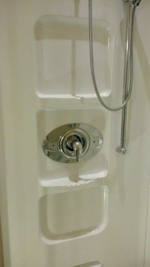 One-handle valve in stand-up shower